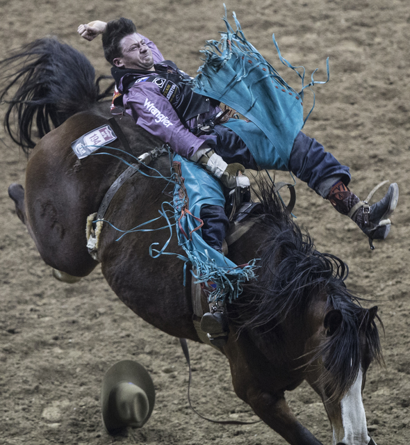 Wyatt Denny rides Angel Eyes during the bareback riding competition at the National Finals Rodeo at the Thomas & Mack Center on Wednesday, Dec. 7, 2016, in Las Vegas. (Benjamin Hager/Las Vegas ...