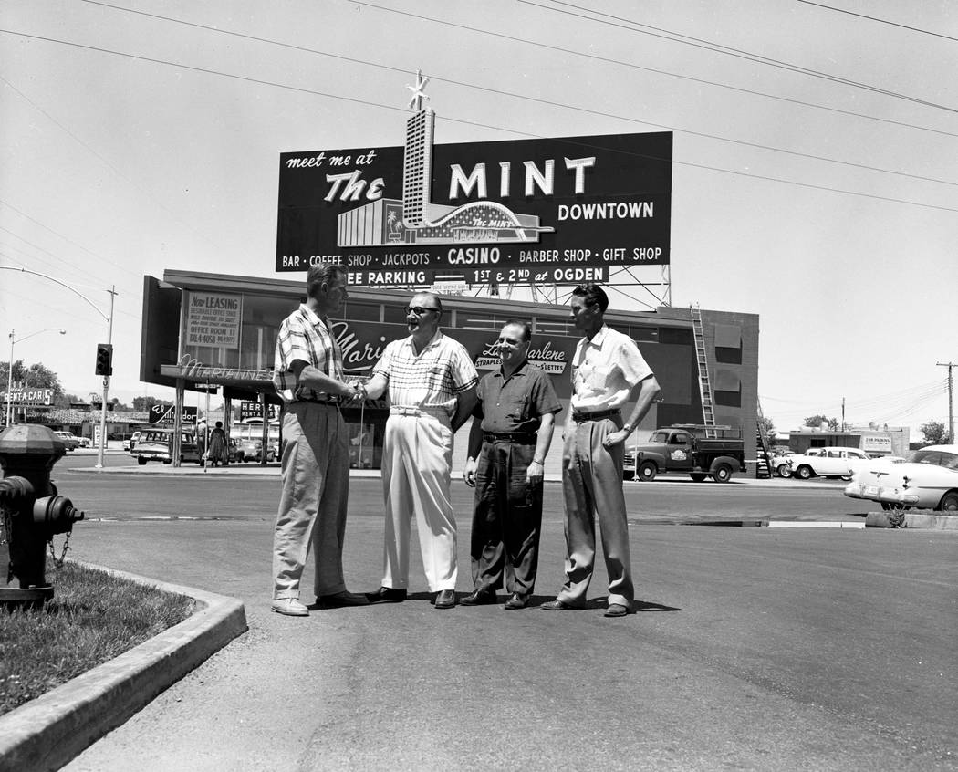 Mint Casino sign on the corner of 5th and San Francisco streets (Las Vegas Boulevard and Sahara Avenue) on January 1, 1959. Photographed are Sam Boyd, Jack Melvin, and two unidentified individuals ...