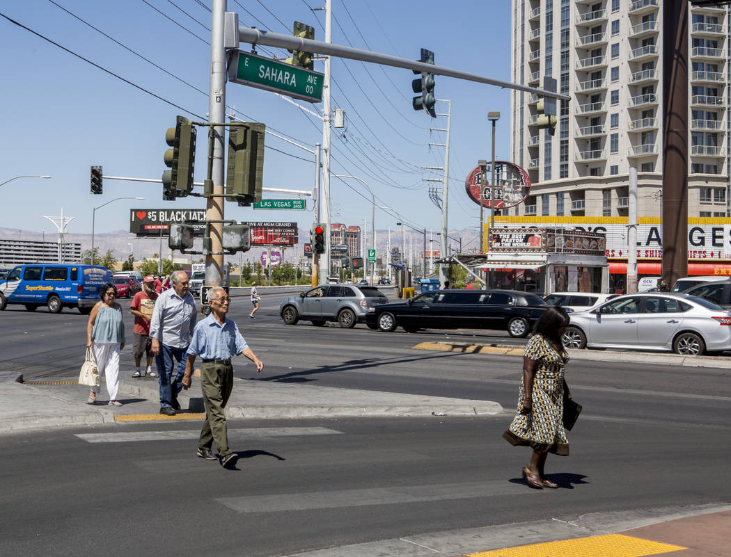 Pedestrians cross Sahara Avenue where it intersects with Las Vegas Boulevard on Monday, June 26, 2017.  Patrick Connolly Las Vegas Review-Journal @PConnPie