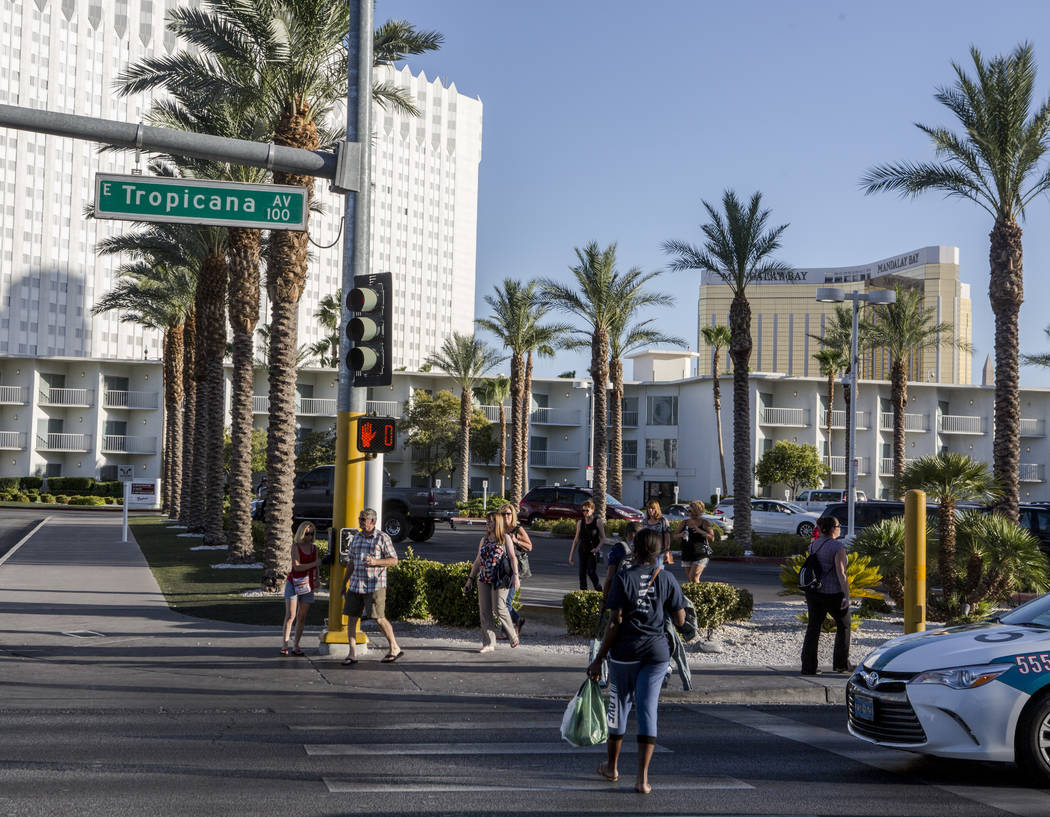 Pedestrians cross Tropicana Avenue on Monday, June 26, 2017.  Patrick Connolly Las Vegas Review-Journal @PConnPie