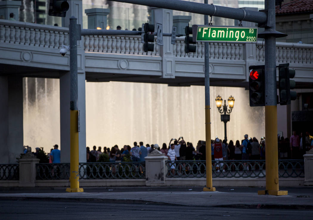 People watch the Bellagio fountain show near Flamingo Road on Monday, June 26, 2017.  Patrick Connolly Las Vegas Review-Journal @PConnPie