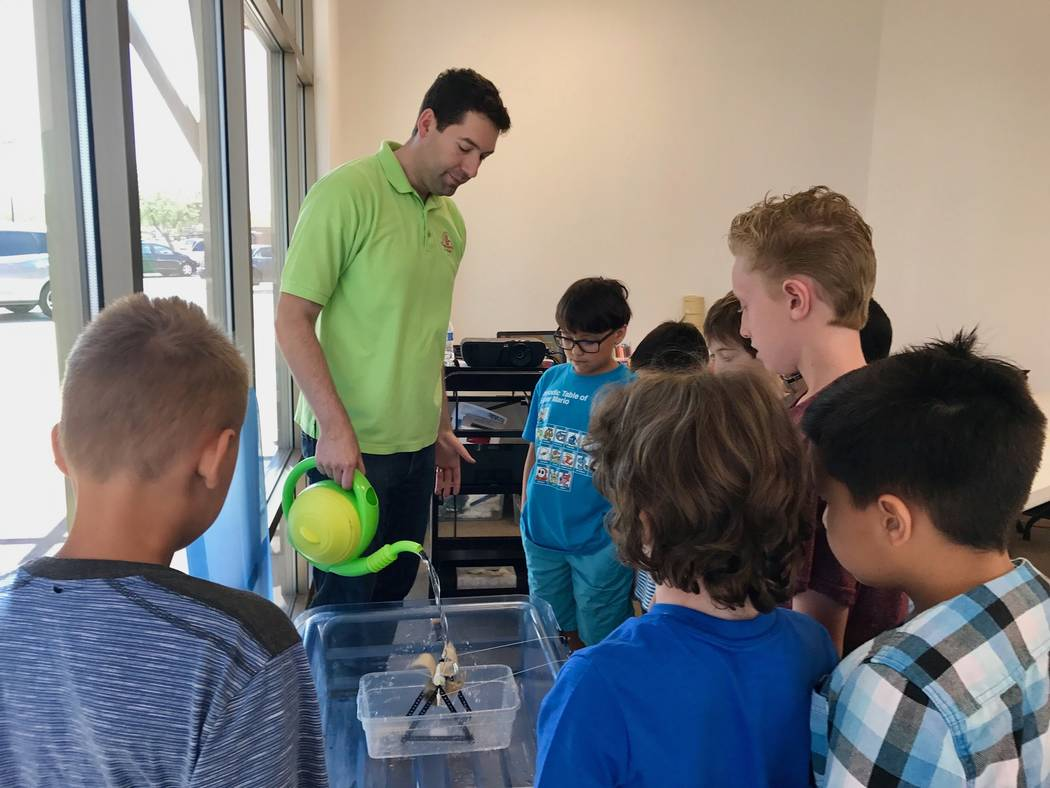 Leo Silva demonstrates how a water turbine generator works in class at Engineering for Kids in Southwest Las Vegas. (Madelyn Reese/View) @MadelynGReese