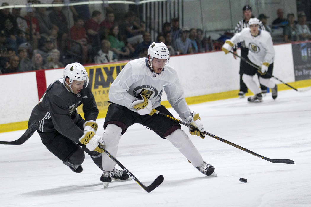 Darian Romanko, center, is pressured by Nick Suzuki during the Vegas Golden Knights Development Camp at the Las Vegas Ice Center in Las Vegas on Saturday, July 1, 2017. Richard Brian Las Vegas Rev ...