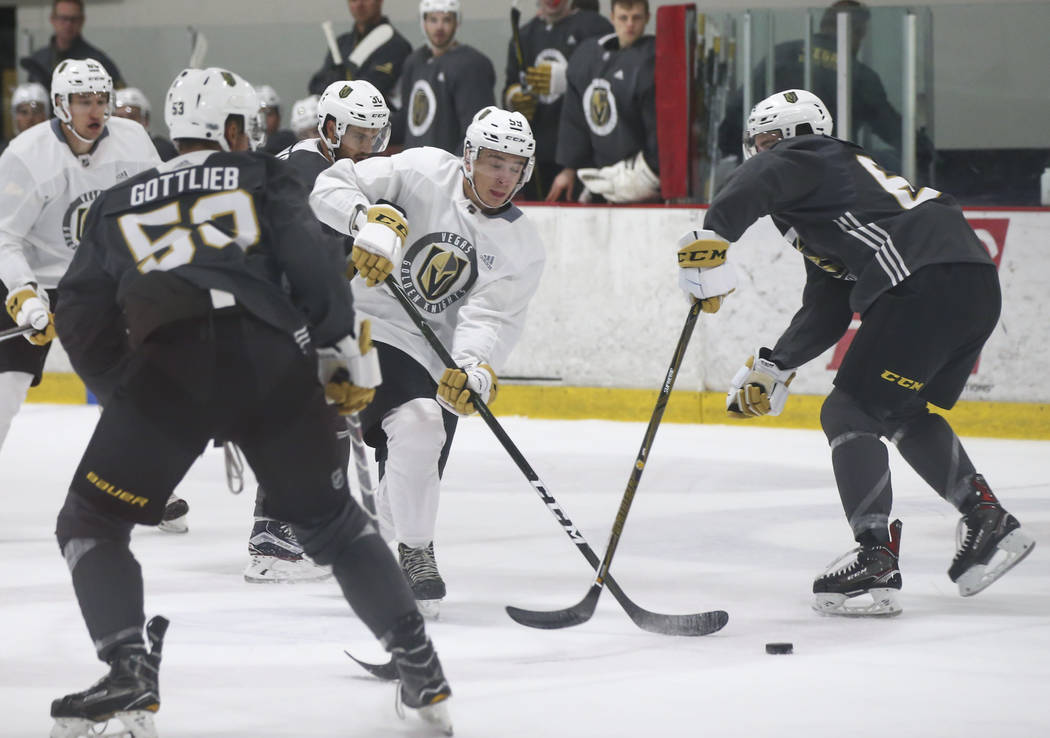 Vegas Golden Knights' Alex Barre-Boulet, center, drives the puck towards the goal during a scrimmage as part of the team's development camp at Las Vegas Ice Center in Las Vegas on Friday, June 30, ...
