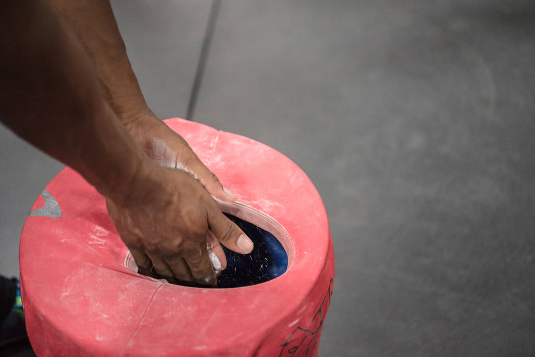 """American Ninja Warrior"" contestant Jelani Allen chalks up his hands at Camp Rhino on Tuesday, June 27, 2017, in Las Vegas. Morgan Lieberman Las Vegas Review-Journal"