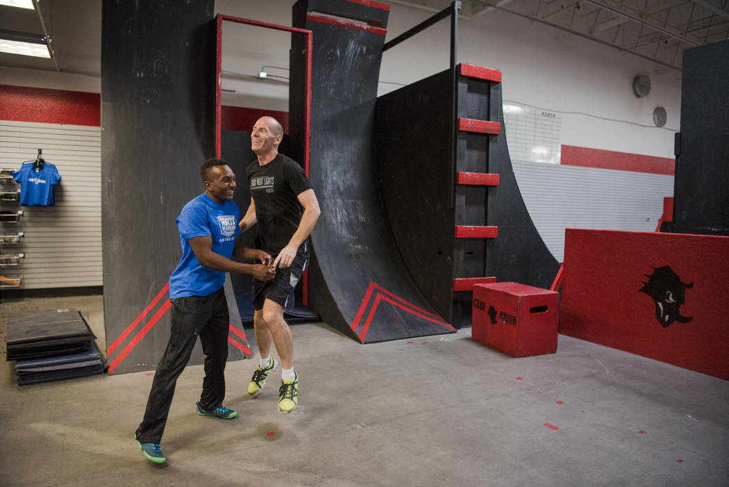 """American Ninja Warrior"" contestant Jelani Allen with instructor D.C. Baker after a game of ""Ninja Tag"" at Camp Rhino on Tuesday, June 27, 2017, in Las Vegas. Morgan Lieberman Las Vegas Review-Journal"