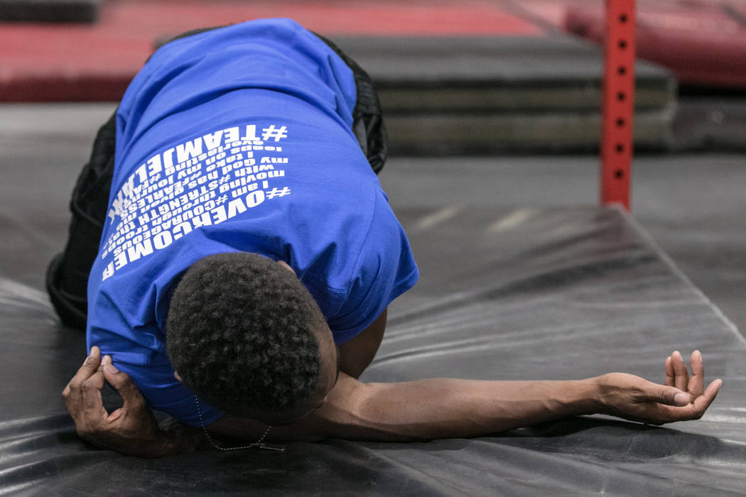 """American Ninja Warrior"" contestant Jelani Allen stretches during training at Camp Rhino on Tuesday, June 27, 2017, in Las Vegas. Morgan Lieberman Las Vegas Review-Journal"