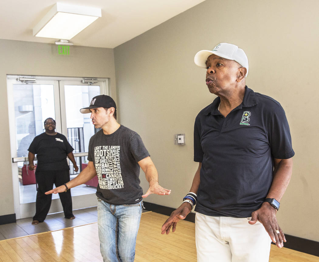 "Director Torrey Russell, left, works with Travis Cloer and Bubba Knight during rehearsal for Broadway in the Hood's show ""From Broadway With Love,"" on Tuesday, June 27, 2017, at Loft 5's studio, i ..."