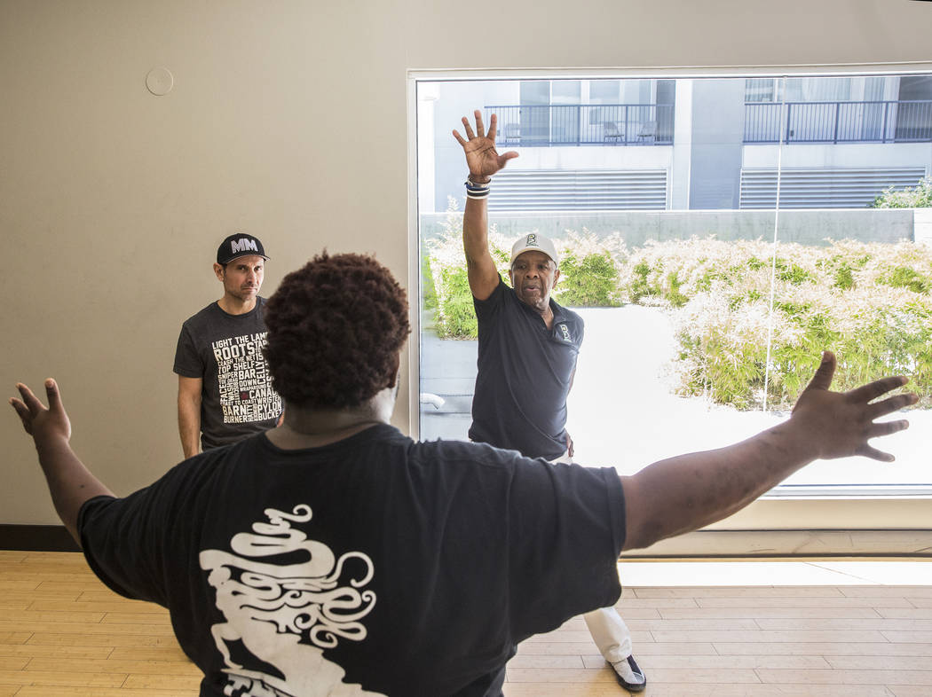 """Director Torrey Russell, front, works with performers Travis Cloer, left, and Bubba Knight during rehearsal for Broadway in the Hood's show """"From Broadway With Love,"""" on Tuesday, June 27, 2017, at ..."""