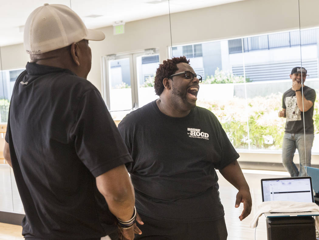 """Director Torrey Russell, middle, jokes with Travis Cloer, right, and Bubba Knight during rehearsal for Broadway in the Hood's show """"From Broadway With Love,"""" on Tuesday, June 27, 2017, at Loft 5's ..."""