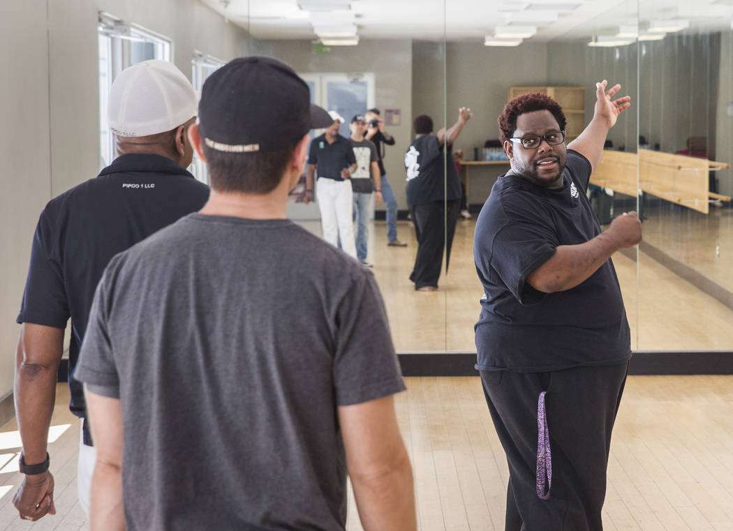 "Director Torrey Russell, right, works with Travis Cloer, middle, and Bubba Knight during rehearsal for Broadway in the Hood's show ""From Broadway With Love,"" on Tuesday, June 27, 2017, at Loft 5's ..."
