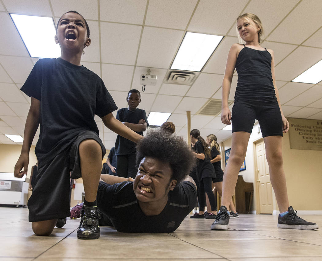 "Emmanuel Chukwurah, left, Stone Farrior and Rori Waters rehearse for Broadway in the Hood's show ""From Broadway With Love,"" on Wednesday, June 28, 2017, at First AME Church, in Las Vegas. Benjamin ..."