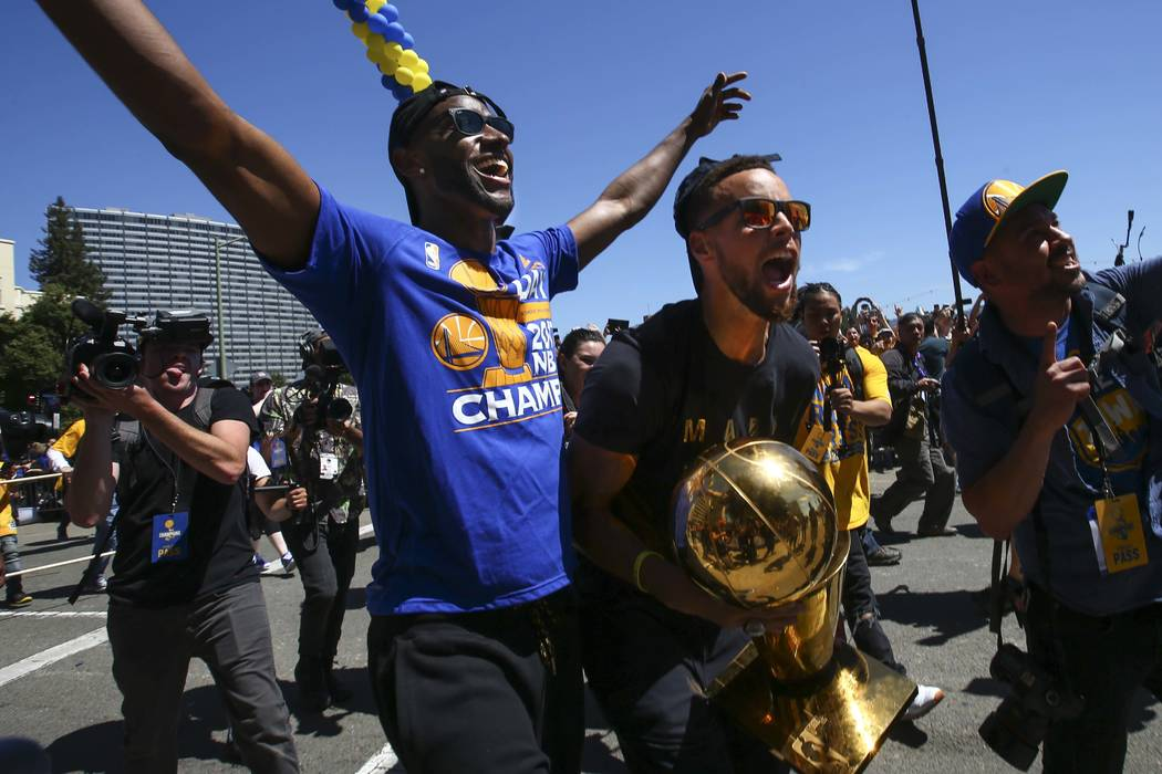 Golden State Warriors' Ian Clark, left, and Stephen Curry during the team's victory parade and rally in downtown Oakland, Calif. on Thursday, June 15, 2017. (Chase Stevens/Las Vegas Review-Journal ...