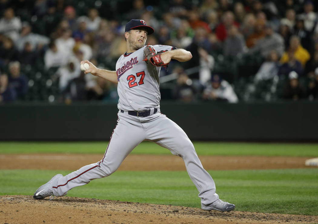 Minnesota Twins closing pitcher Brandon Kintzler throws against the Seattle Mariners during the ninth inning of a baseball game, Thursday, June 8, 2017, in Seattle. Kintzler earned the save as the ...