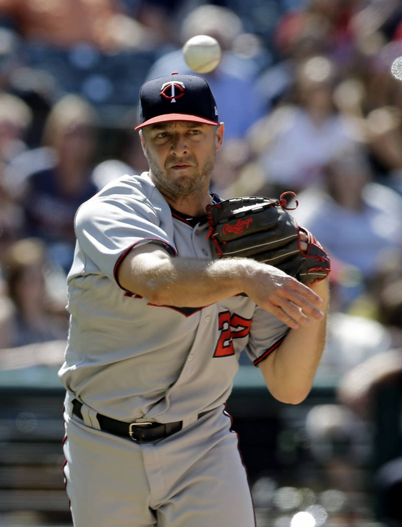 Minnesota Twins relief pitcher Brandon Kintzler throws out Cleveland Indians' Bradley Zimmer in the ninth inning of a baseball game, Sunday, June 25, 2017, in Cleveland. (AP Photo/Tony Dejak)