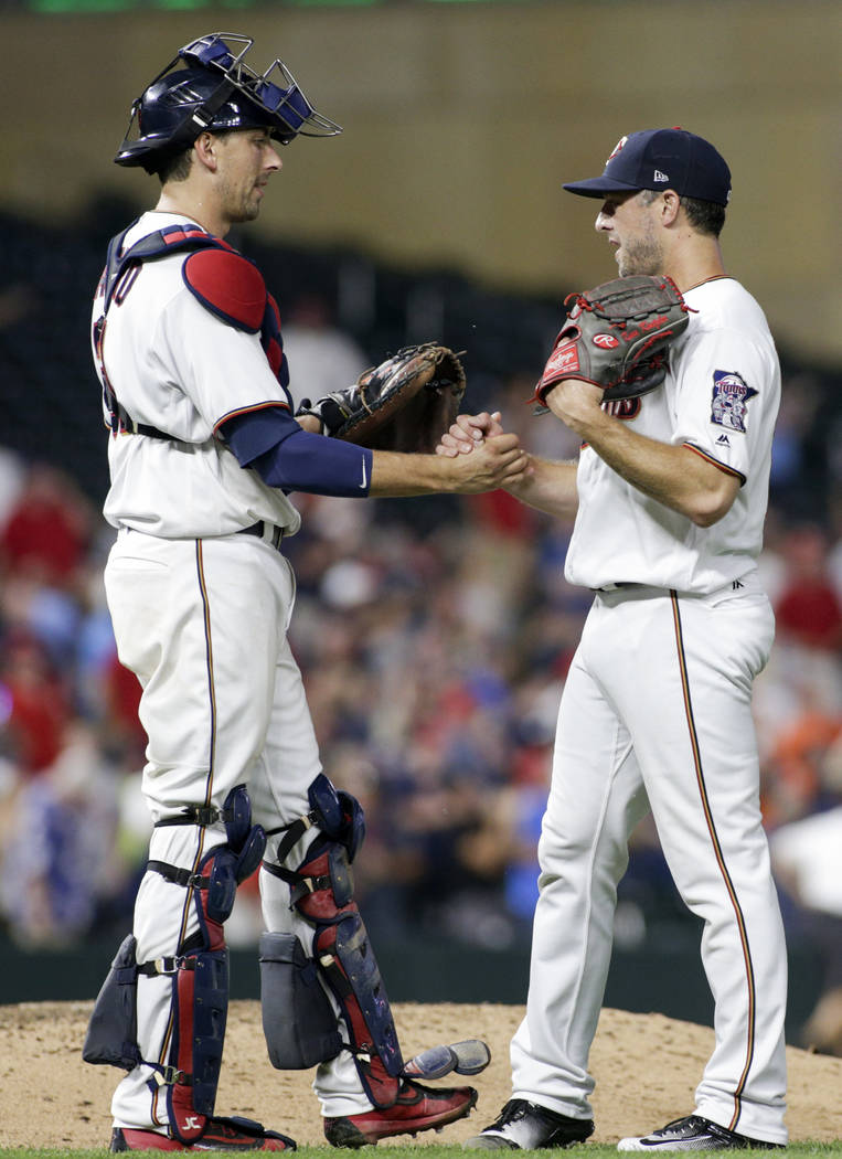 Minnesota Twins relief pitcher Brandon Kintzler, right, is congratulated by Jason Castro after the Twins defeated the Baltimore Orioles 6-4 in a baseball game, Thursday, July 6, 2017, in Minneapol ...