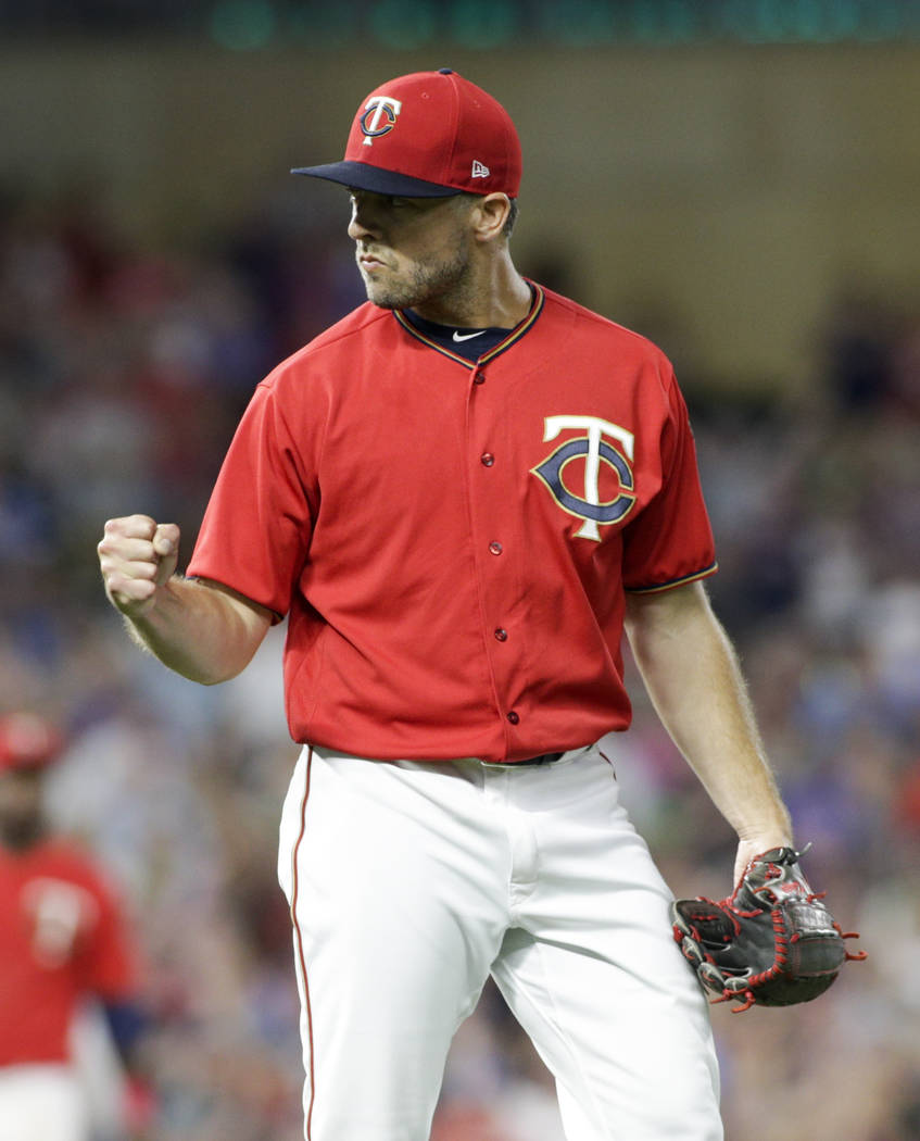 Minnesota Twins relief pitcher Brandon Kintzler pumps his fist after the Twins defeated the Baltimore Orioles 9-6 in a baseball game, Friday, July 7, 2017, in Minneapolis. (AP Photo/Paul Battaglia)