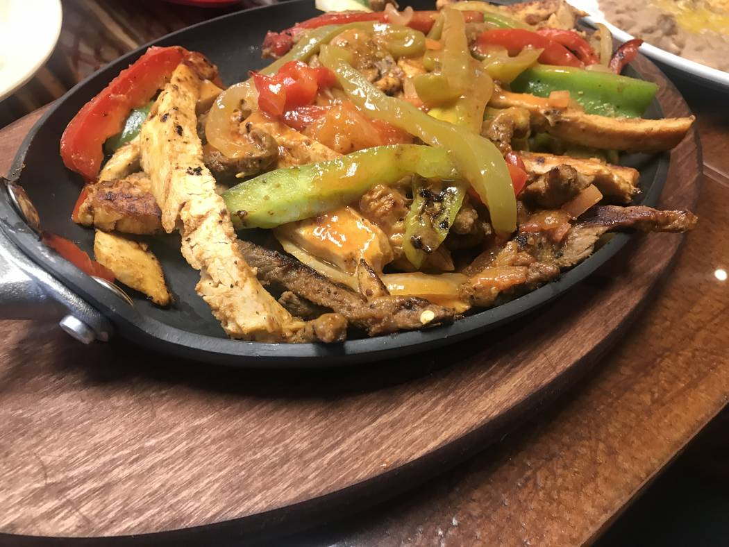 Fajitas are served with chicken and beef June 25 at El Nopal Mexican Grill, 955 W Craig Rd #100a. (Kailyn Brown/View) @KailynHype
