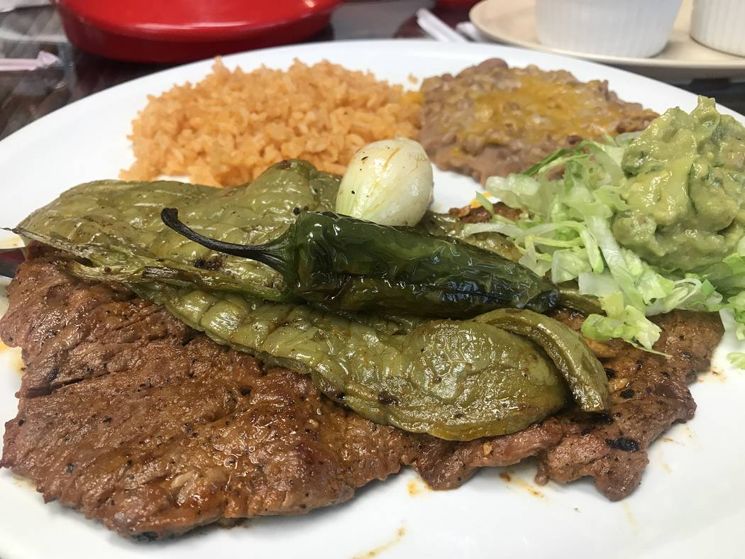 The Carne Asada Plate comes is served with beans, rice, guacamole and tortillas June 25 at El Nopal Mexican Grill, 955 W Craig Rd #100a. (Kailyn Brown/View) @KailynHype