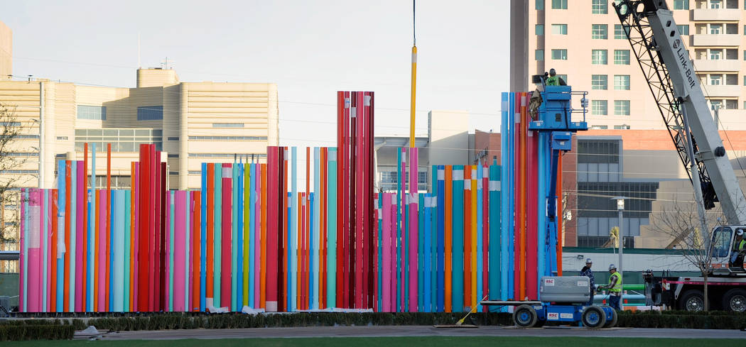 LaPaloma Fine Arts workers install a sculpture outside the Smith Center For The Performing Arts in Las Vegas on Wednesday, Feb. 29, 2012. The sculpture is a creation of local artist Tim Bavington. ...