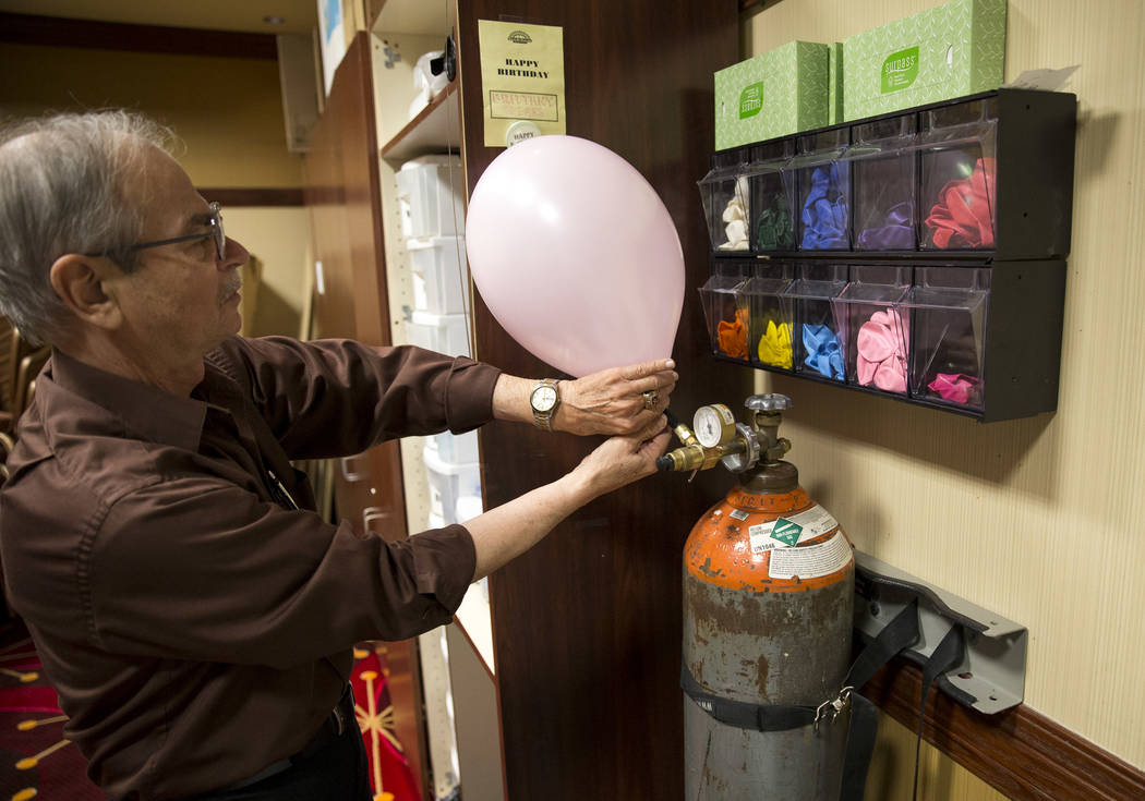 "North Las Vegas resident Victor ""Frenchy"" Letourneau, 72, an events ambassador for Santa Fe Station, prepares a helium balloon at the Santa Fe Station Bowling Center on Wednesday, June 28, 2017.   ..."