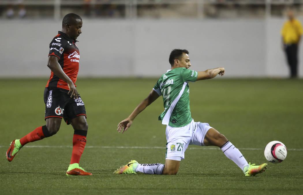 Len's defender Osvaldo Rodriguez (24) kicks the ball past Tijuana's Mauricio Cuero during an exhibition soccer match at Sam Boyd Stadium in Las Vegas on Saturday, July 8, 2017. Chase Stevens Las V ...