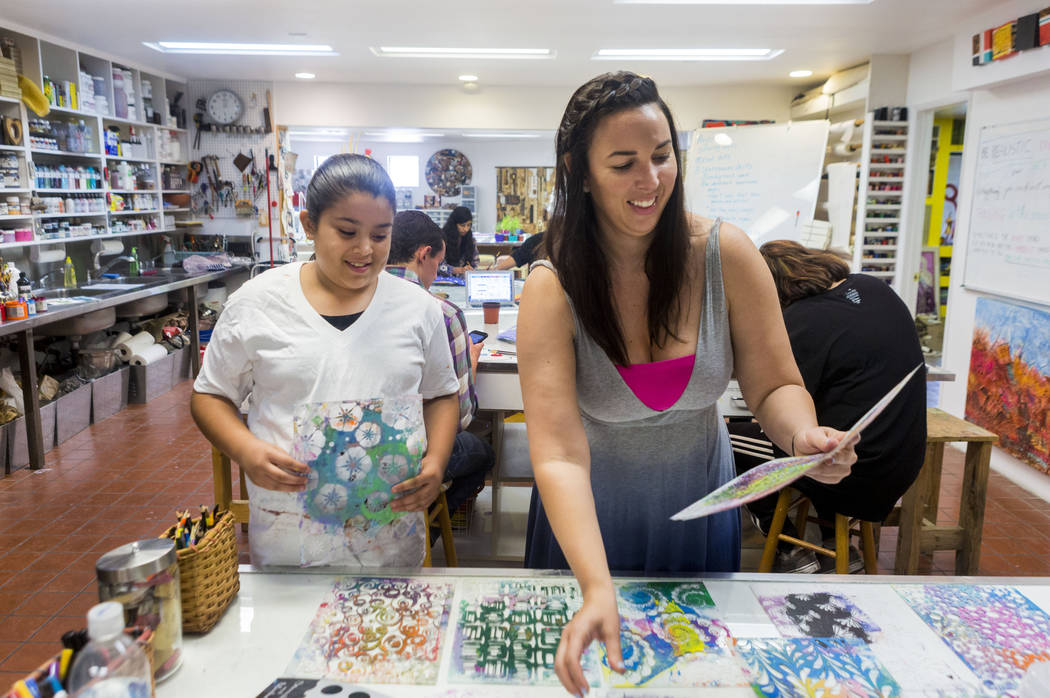West Prep student Aracely Hernandez, 11, left, and Core Academy instructor Rachel Martin during an art summer camp at the late Joyce Straus' home in Las Vegas, Thursday, July 13, 2017. Elizabeth B ...