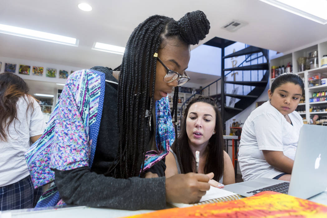 West Prep student Shanette Roberson, 15, left, learns drawing techniques from Core Academy instructor Rachel Martin during an art summer camp at the late Joyce Straus' home in Las Vegas, Thursday, ...