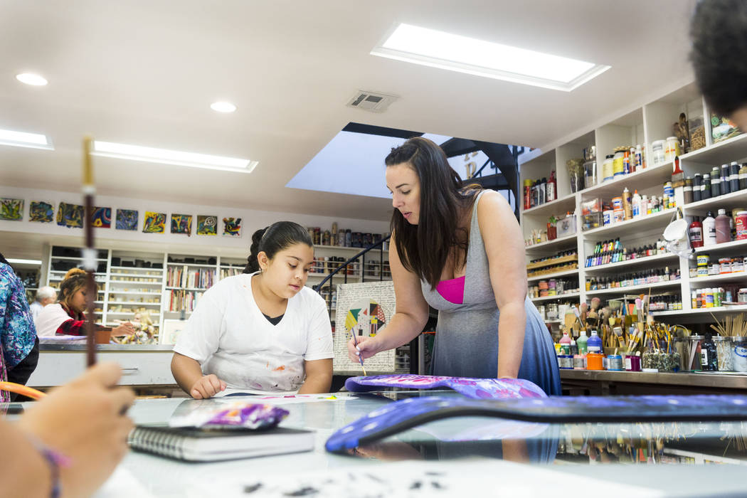 West Prep student Aracely Hernandez, 11, left, learns painting techniques from Core Academy instructor Rachel Martin during an art summer camp at the late Joyce Straus' home in Las Vegas, Thursday ...