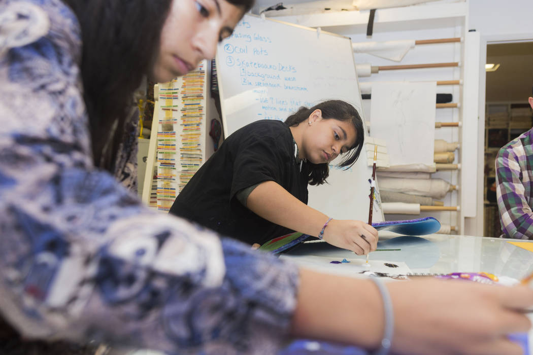 West Prep students Yamileth Henriquez, 13, left, and Natalie Maldonado, 13, partake in an art summer camp at the late Joyce Straus' home in Las Vegas, Thursday, July 13, 2017. Elizabeth Brumley La ...