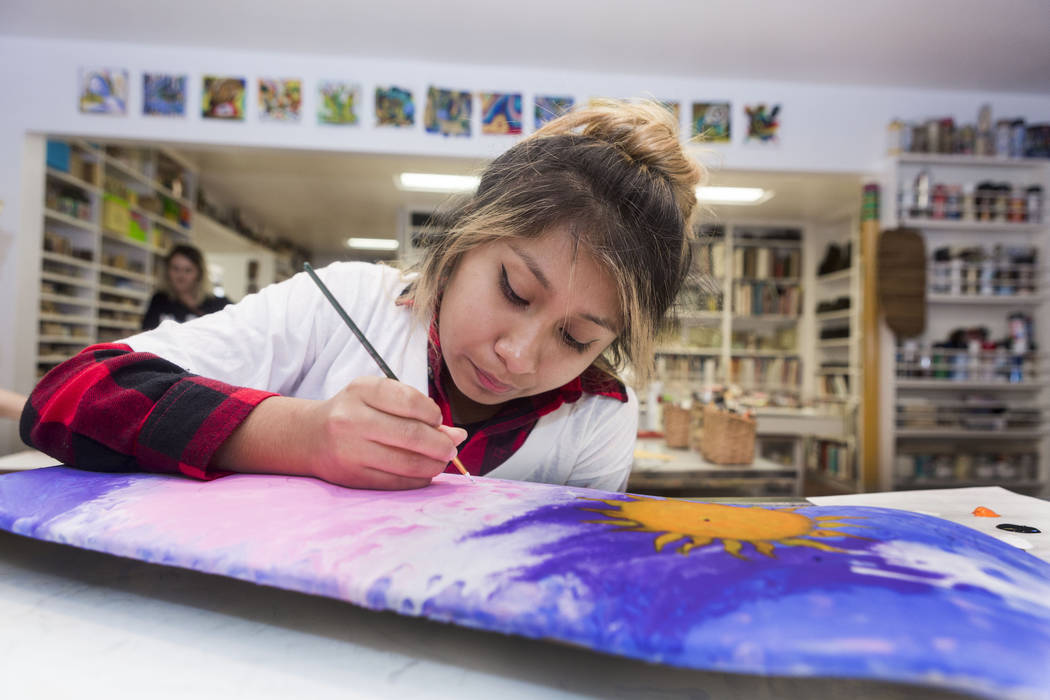 West Prep student Kelsey Reyes-Perez, 16, works on her painted skateboard at an art summer camp at the late Joyce Straus' home  in Las Vegas, Thursday, July 13, 2017. Elizabeth Brumley Las Vegas R ...