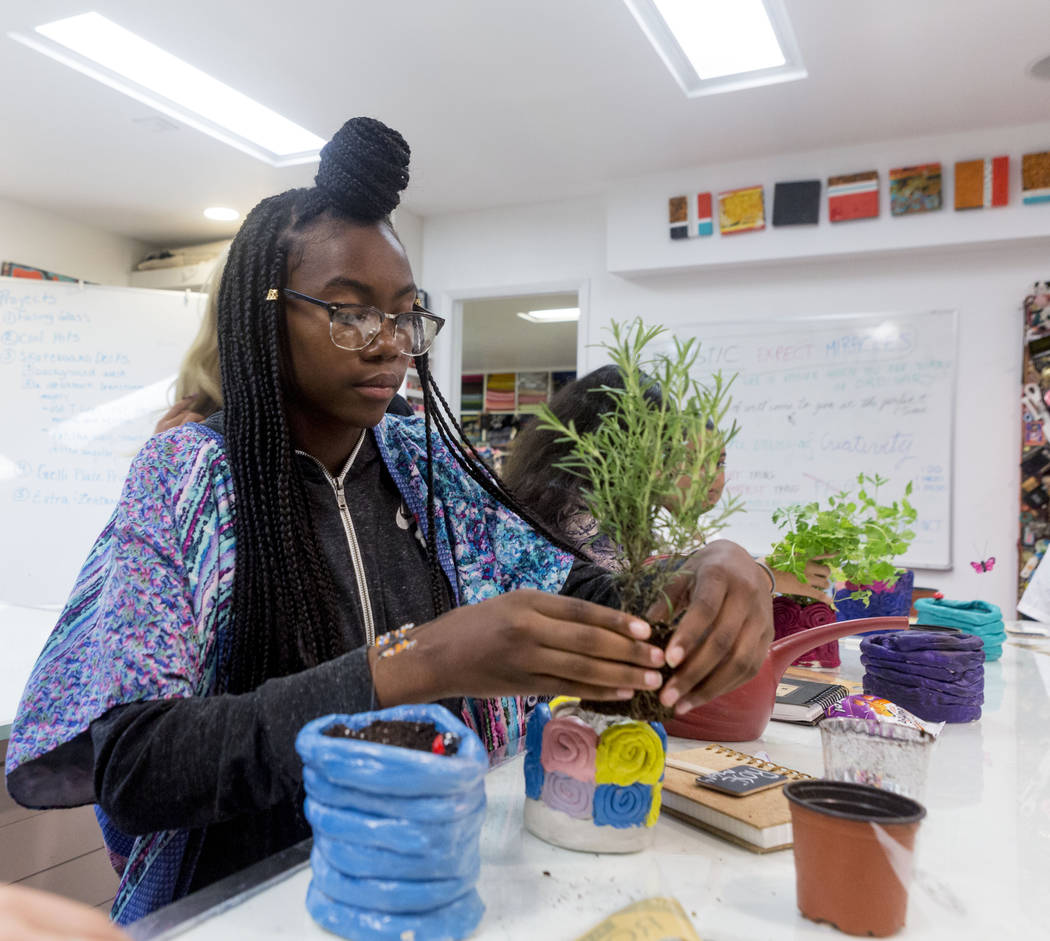 West Prep student Shanette Roberson, 15, plants a rosemary in her homemade clay pot at an art summer camp at the late Joyce Straus' home in Las Vegas, Thursday, July 13, 2017. Elizabeth Brumley La ...