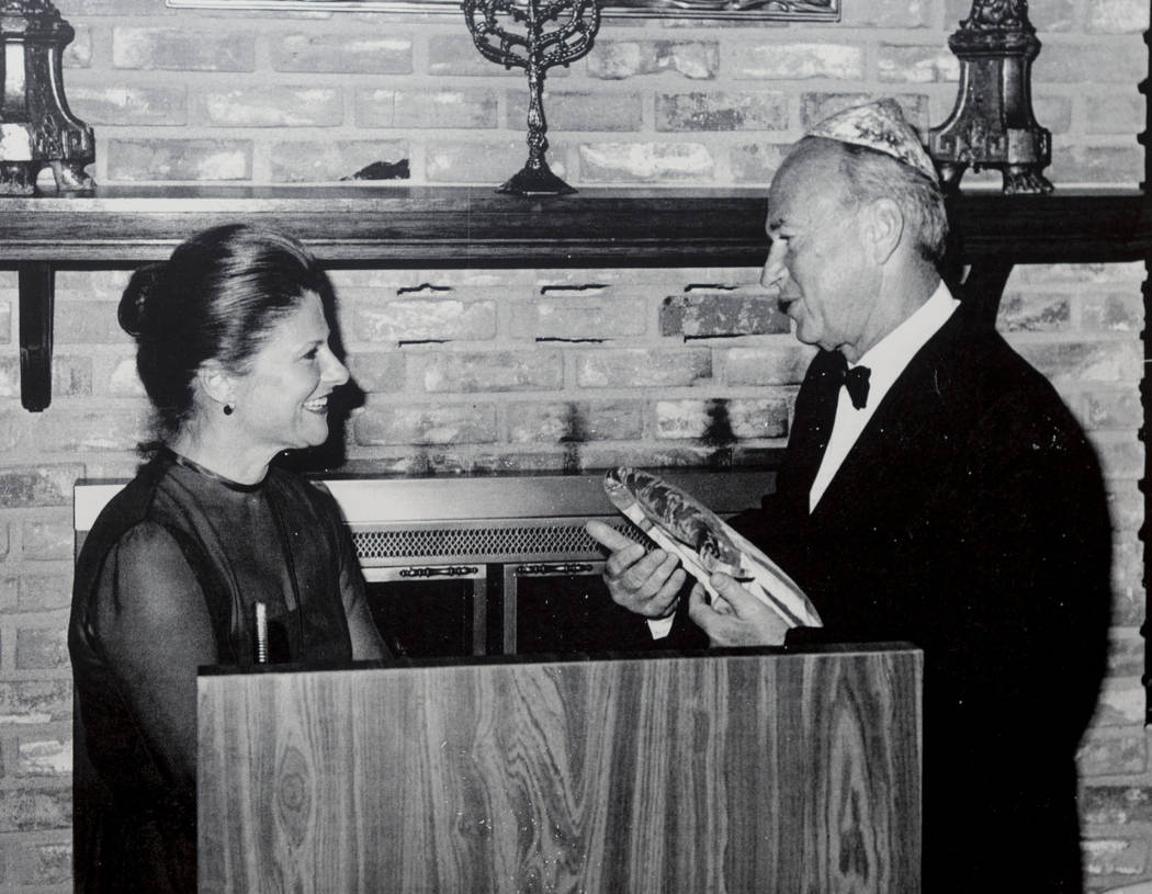 Joyce Straus gives a gift to former President of Israel Shimon Peres in Las Vegas. Photo provided by Straus family.