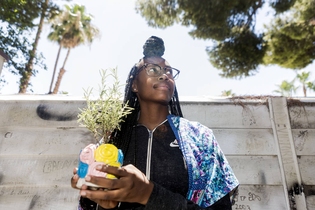 West Prep student Shanette Roberson, 15, holds her handmade pot and planted herb she made at an art summer camp at the late Joyce Straus' home in Las Vegas, Thursday, July 13, 2017. Elizabeth Brum ...