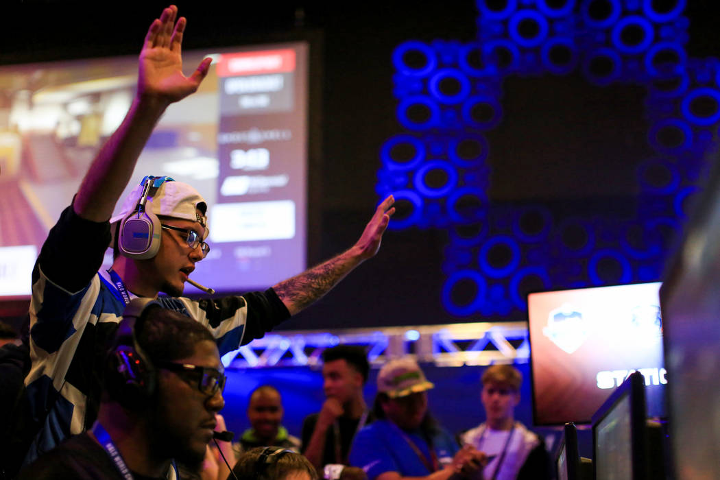 Brandon (Le Le) of G4C esports, top left, reacts to his team winning a game during the Halo World Championship North American Qualifier at thE Arena in downtown Las Vegas on Friday, March 3, 2017, ...
