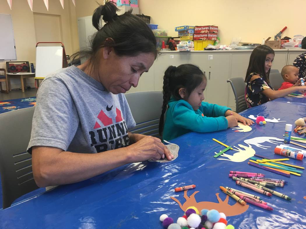 Suzy Rendo does arts and crafts with Jamie Rendo, her niece, during the exploration lab program at the Clark County Library on June 26, 2017.  The Clark County Library expands on their reading pro ...
