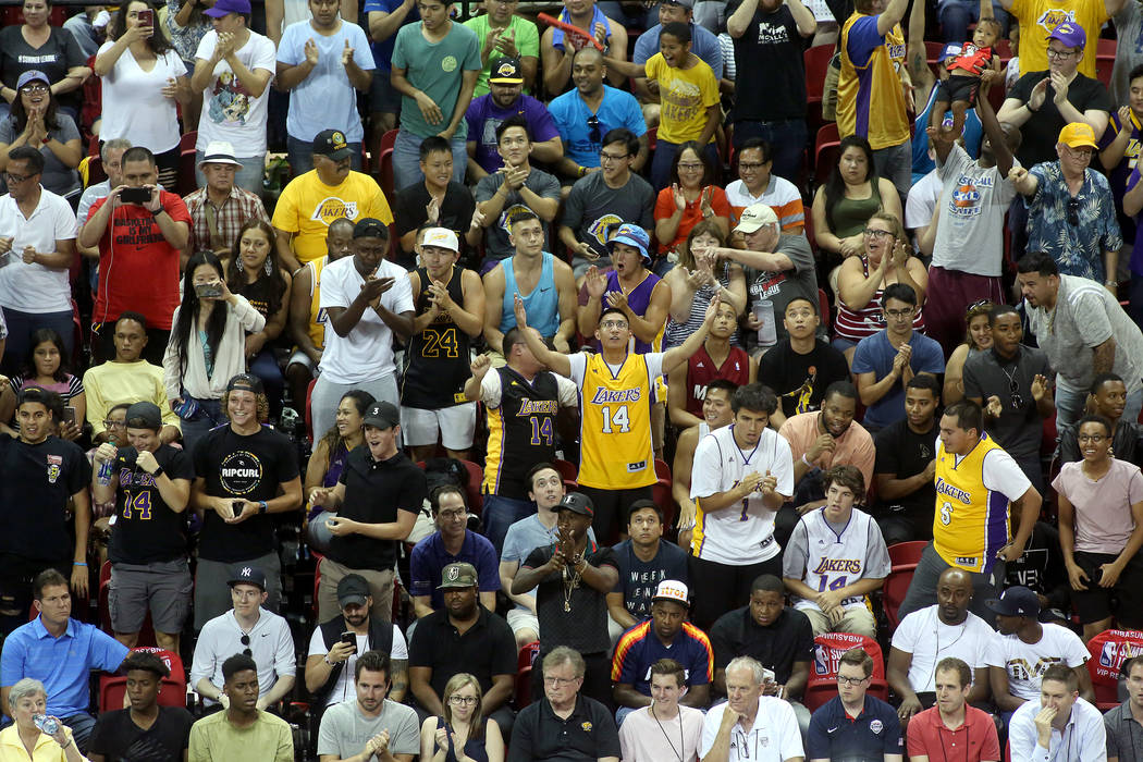 Los Angles Lakers fans react to a play during the team's NBA Summer League game against the Boston Celtics on Saturday, July 8, 2017. This is the first sold out game in Las Vegas' NBA Summer Le ...