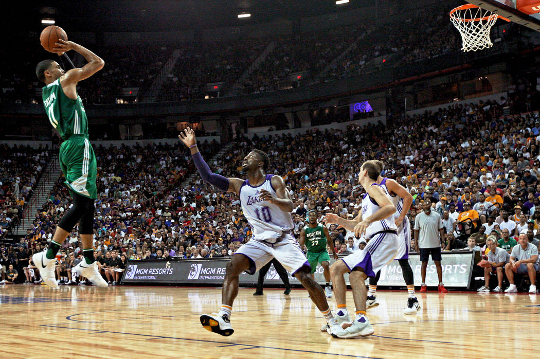 Boston Celtics guard Jayson Tatum (11) scores a three-pointer during the Celtics NBA Summer League game against the Los Angeles Lakers at Thomas and Mack Center in Las Vegas on Saturday, July 8, 2 ...