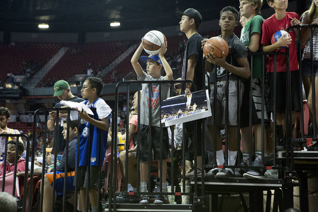 Fans wait in hopes to get things signed by player after the Los Angeles Lakers NBA Summer League game against the Boston Celtics at Thomas and Mack Center in Las Vegas on Saturday, July 8, 2017.&# ...