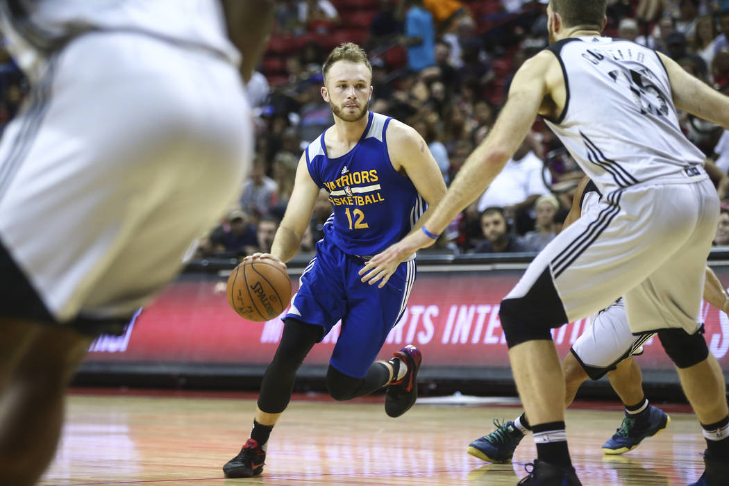 Golden State Warriors' Bryce Alford (12) drives against the Minnesota Timberwolves during a basketball game at the NBA Summer League at the Thomas & Mack Center in Las Vegas on Tuesday, July 1 ...