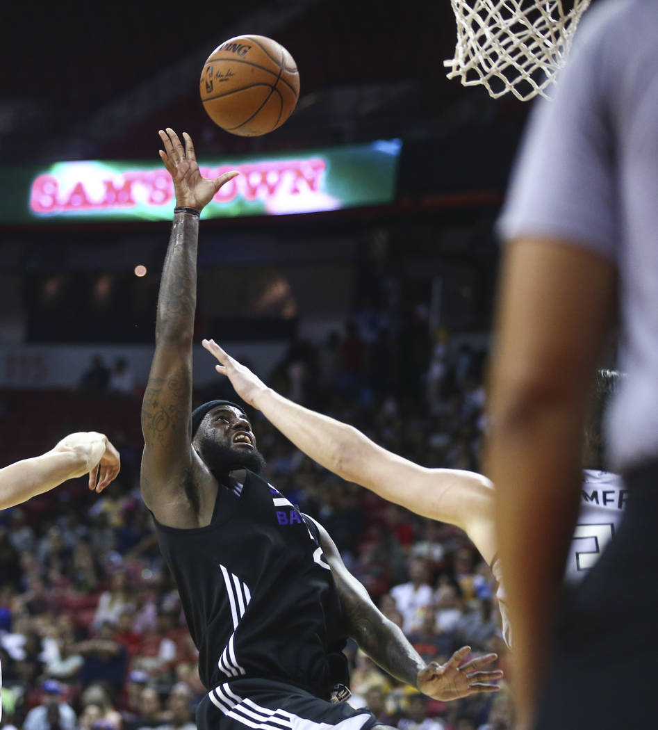 Sacramento Kings' JaKarr Sampson (29) sends up a shot against the Milwaukee Bucks during a basketball game at the NBA Summer League at the Thomas & Mack Center in Las Vegas on Wednesday, July  ...