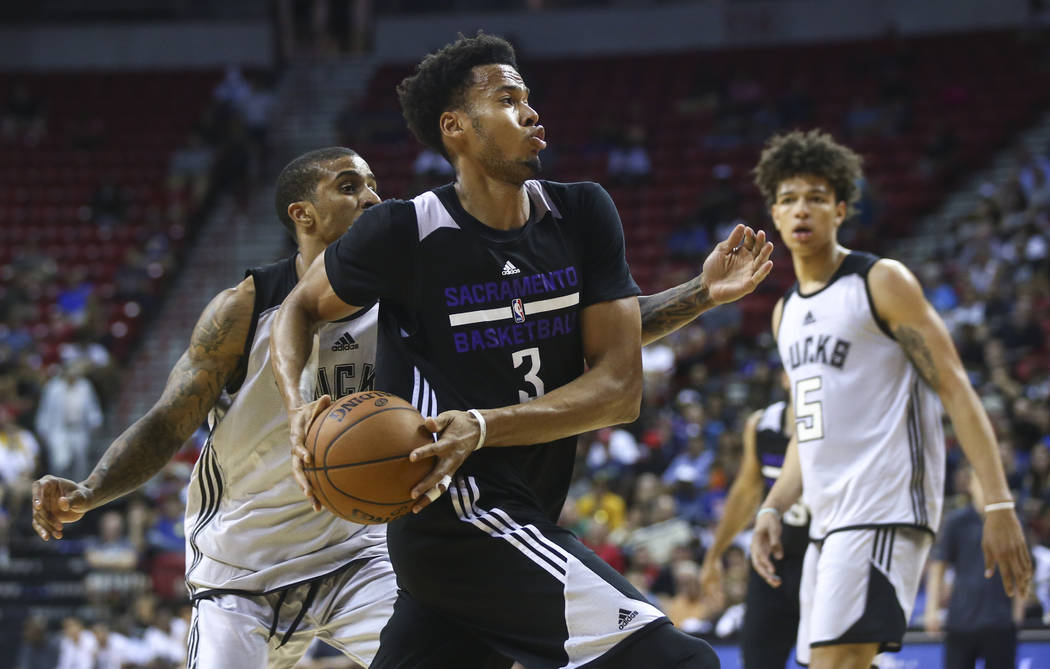 Sacramento Kings' Skal Labissiere (3) drives to the basket against the Milwaukee Bucks during a basketball game at the NBA Summer League at the Thomas & Mack Center in Las Vegas on Wednesday,  ...