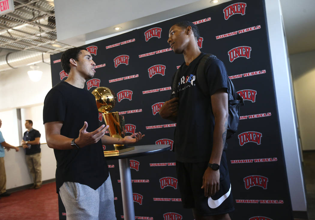 Golden State Warriors' Patrick McCaw, right, talks with fellow former UNLV player Austin Starr next to the Larry O'Brien Trophy in Mendenhall Center at UNLV in Las Vegas on Friday, July 14, 2017.  ...