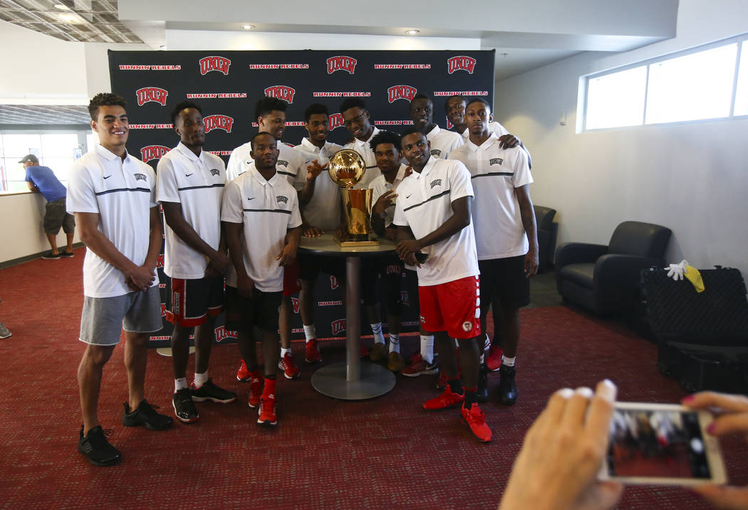 UNLV basketball players get up close with the Larry O'Brien Trophy in Mendenhall Center at UNLV in Las Vegas on Friday, July 14, 2017. Chase Stevens Las Vegas Review-Journal @csstevensphoto