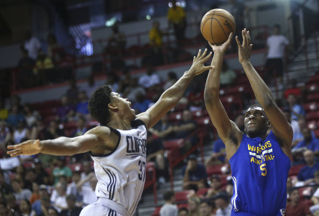 Golden State Warriors' Kevon Looney (5) shoots as Los Angeles Clippers' Isaiah Hicks (37) defends during a basketball game at the NBA Summer League at the Thomas & Mack Center in Las Vegas on  ...