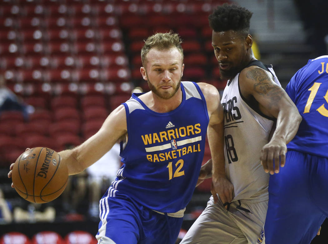 Golden State Warriors' Bryce Alford (12) drives to the basket against Los Angeles Clippers' James Bell (18) during a basketball game at the NBA Summer League at the Thomas & Mack Center in Las ...