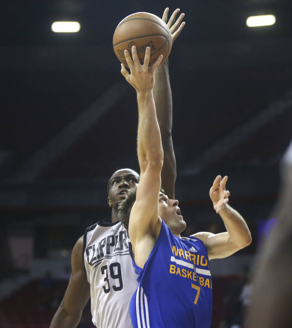 Los Angeles Clippers' Jameel Warney (39) blocks a shot from Golden State Warriors' Joe Rahon (7) during a basketball game at the NBA Summer League at the Thomas & Mack Center in Las Vegas on F ...