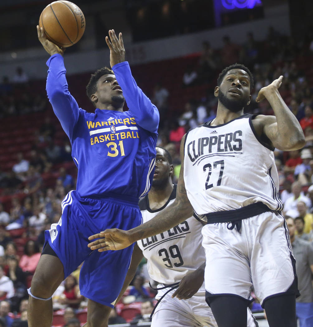 Golden State Warriors' Dylan Ennis (31) shoots over Los Angeles Clippers' Jamil Wilson (27) during a basketball game at the NBA Summer League at the Thomas & Mack Center in Las Vegas on Friday ...