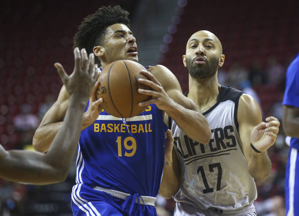 Golden State Warriors' Tai Webster (19) drives to the basket against Los Angeles Clippers' Kendall Marshall (17) during a basketball game at the NBA Summer League at the Thomas & Mack Center i ...