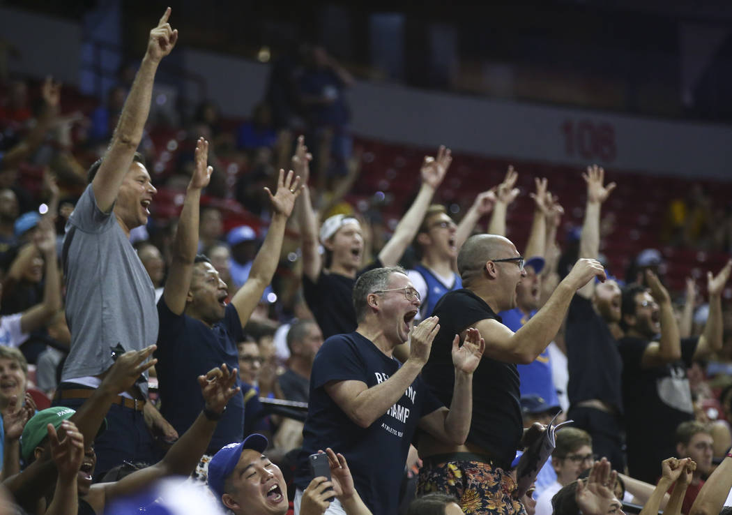 Golden State Warriors fans react during a basketball game against the Los Angeles Clippers at the NBA Summer League at the Thomas & Mack Center in Las Vegas on Friday, July 14, 2017. Chase Ste ...